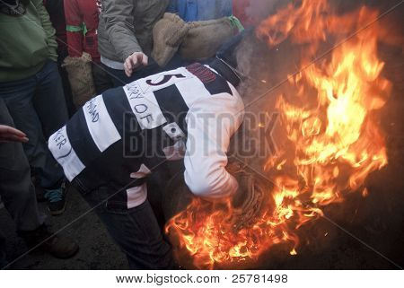 A Young Roller Attempts To Pick Up A Burning Tar Barrel At The Start Of The 2011 Tar Barrels Of Otte