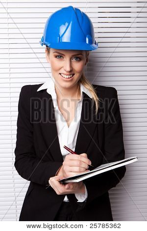 Smiling Businesswoman In Hard Hat