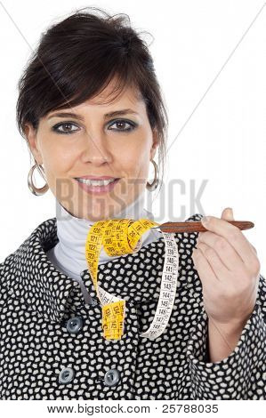 attractive girl with  tape measure in the hand a over white background