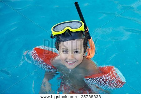 photo of an adorable boy learning to swim