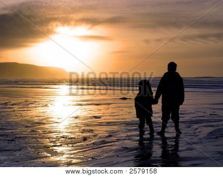 Boys Watching A Beach Sunset