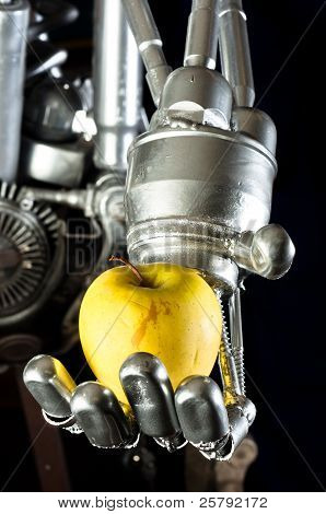 A Robot Hand With Green Fruit