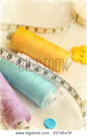 Spool of thread and pins. Sewing accessories