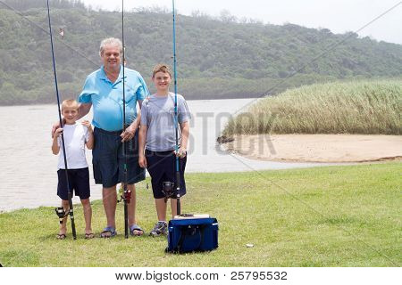 grandfather and grandsons fishing by the lake