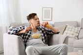 Lazy Man With Bottle Of Beer And Chips Watching Tv At Home poster