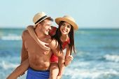 Happy Young Couple Having Fun At Beach On Sunny Day poster