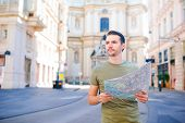 Man Tourist With A City Map In Europe Street. Caucasian Boy Looking With Map Of European City. poster