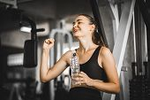 Fit Young Woman Caucasian Sitting And Resting After Workout Or Exercise In Fitness Gym. Woman At Gym poster