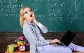 Woman Tired Teacher Work Laptop Classroom Chalkboard Background. Working Conditions Which Prospectiv poster