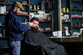Hipster Client Getting Haircut. Barber With Hair Clipper Work On Hairstyle For Hipster, Barbershop B poster