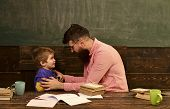 Male Teacher Explaining Something To The Boy. Side View Bearded Man In Glasses And Blond Child In Fr poster
