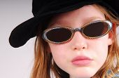 image of pouty lips  - Young girl in black cap and sunglasses - JPG