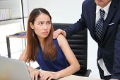 Angry Unhappy Asian Secretary Woman Looking Hands Boss Touching Her Shoulder In Workplace. Sexual H poster