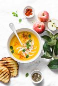 Roasted Pumpkin And Apples Vegetarian Soup On Light Background, Top View. Flat Lay. Healthy Vegetari poster