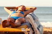 Woman Sleeping On The Chaise Longue