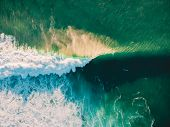 Aerial View Of Crashing Wave In Ocean With Warm Sunset Light. Wave Crashing On Reef. Top View poster
