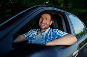 Young Man In Car Smiling
