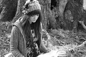 image of girl reading book  - pretty young girl sitting under tree reading a book in black and white - JPG