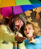 Couple Dating. Hipster With Beard And Cheerful Girl Expect Rainy Weather Hold Colorful Umbrella. Man poster