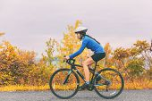 Bike cyclist outdoor woman biking road bicycle in autumn foliage nature. poster