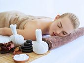 Young Womans relaxing in a spa salon after massage.  Beauty treatment concept. Deep and tranquil re poster