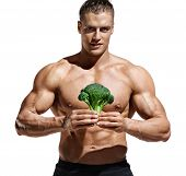 Sporty Man Holding Broccoli As Symbol Healthy Food. Photo Of Handsome Man With Naked Torso And Good  poster