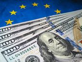 Us Dollars On Background Of Eu Flag. Eurozone, European Economy Concept, Trade And Investment Betwee poster