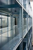 picture of lineup  - a lineup of racks for storage in a warehouse - JPG