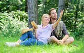 Couple In Love Spend Leisure In Park Or Forest. Romantic Couple Students Enjoy Leisure Looking Upwar poster