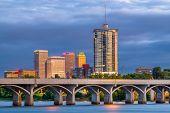 Tulsa, Oklahoma, USA downtown skyline on the Arkansas River at dusk. poster