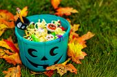 Halloween Teal Basket Full Of Non-food Treats. Halloween Party Favors For Kids With Food Allergy. Te poster