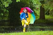 Little Girl With Umbrella In The Rain poster