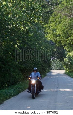 Biker On Country Road