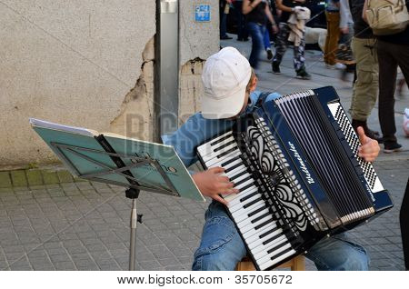 Child Plays Ancient Accordion. Street Music Day