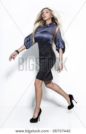 Blond Beautiful Woman Jump On The White Studio Background
