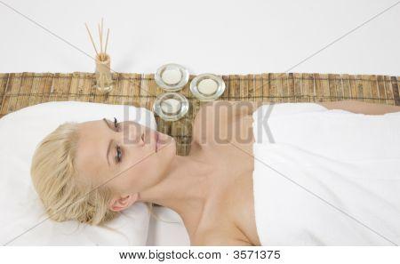 Woman Lying On Massage Mat
