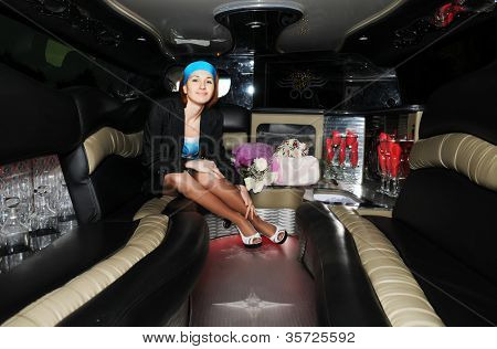 beautiful woman in a limousine