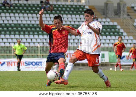 KAPOSVAR, HUNGARY - JULY 21: Unidentified players in action at the VIII. Youth Football Festival U16 Final Pozo Almonte (white) (CHI) vs. FC Makedonija (orange)(MKD) July 21, 2012 in Kaposvar, Hungary