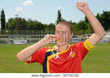 KAPOSVAR, HUNGARY - JULY 21: Unidentified Macedon player celebrates at the VIII. Youth Football Festival U16 Final Pozo Almonte (yellow) (CHI) vs. FC Makedonija (white) (MKD) July 21, 2012 in Kaposvar, Hungary