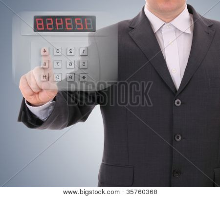 Man entering safe code