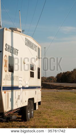 CREEK COUNTY, OKLAHOMA - AUGUST 6 2012: sheriff's command post in the intersection of highways 48 and 33 against wildfire burned background  on August 6, 2012 in rural Creek County, Oklahoma, USA