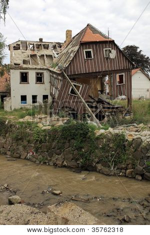 BOGATYNIA, POLAND - SEPTEMBER 1: Old house damaged by flood inundation in Bogatynia, Poland on September 1, 2011.