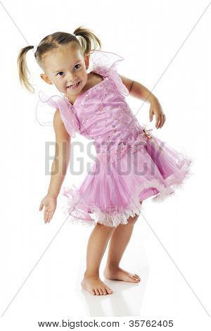 An adorable preschooler, barefoot in a frilly pink dress, arching her back in gesture.  On a white background.