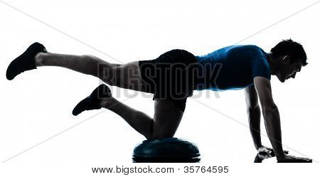 one caucasian man exercising bosu workout fitness in silhouette studio  isolated on white background
