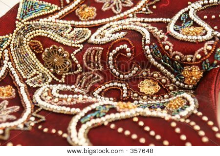 Beautiful Pattern Of Beads And Pearls On Fabric