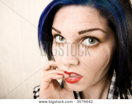 Wide Angle Portrait Of A Apprehensive Rockabilly Girl