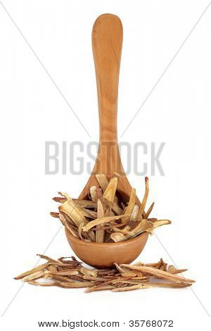 Licorice root used in traditional chinese herbal medicine on white background. Gan cao, radix glyrrhizae