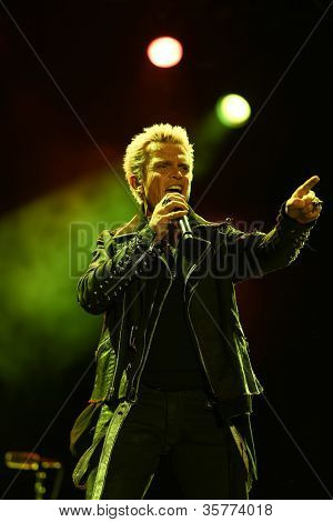 FARO, PORTUGAL - JULY 21: Billy Idol performs onstage at the International Motorcycle Meeting JULY 21, 2012 in Faro, Portugal.