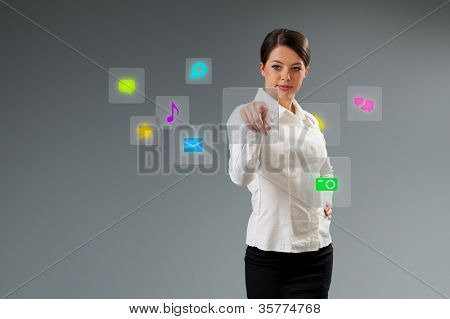 Media interface pressing button. Cute brunette touching the button. Pushing technology. Future push interface collection.