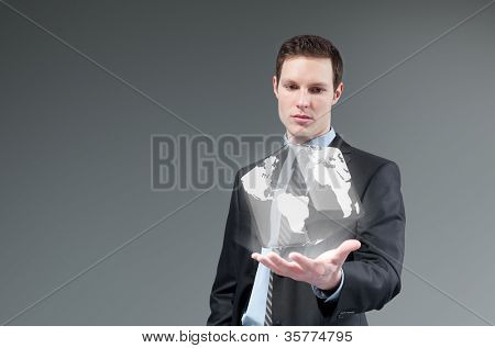 International business technology concept. Globe from businessman palm. Young man generating cube world. Future collection series.